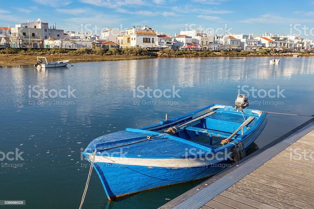 Traditional Portuguese boat at the dock. View Cabanas de Tavira. stock photo