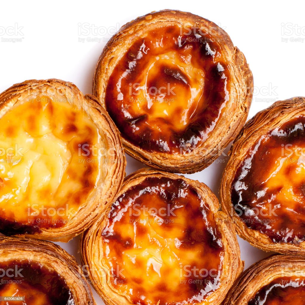 Traditional portuguese specialty tart name Nata isolated on white background close up stock photo
