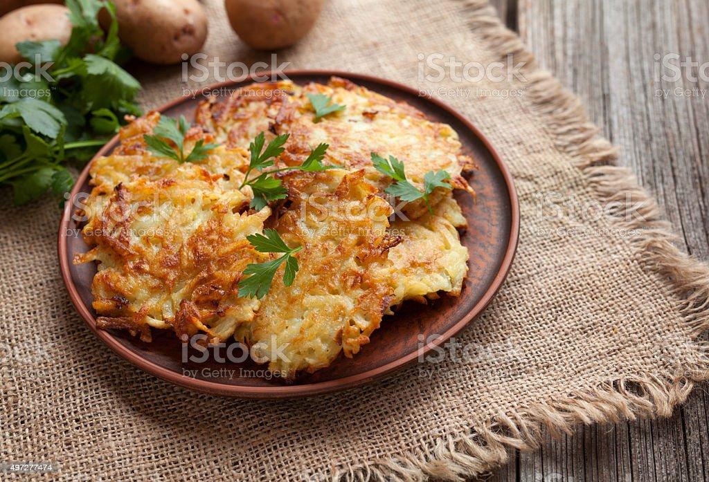 Traditional potato pancakes or latke homemade jewish food Hanukkah celebration stock photo