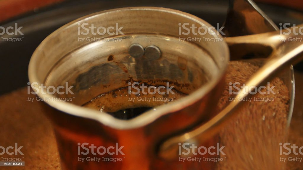 Traditional process boil Turkish coffee in turk stock photo