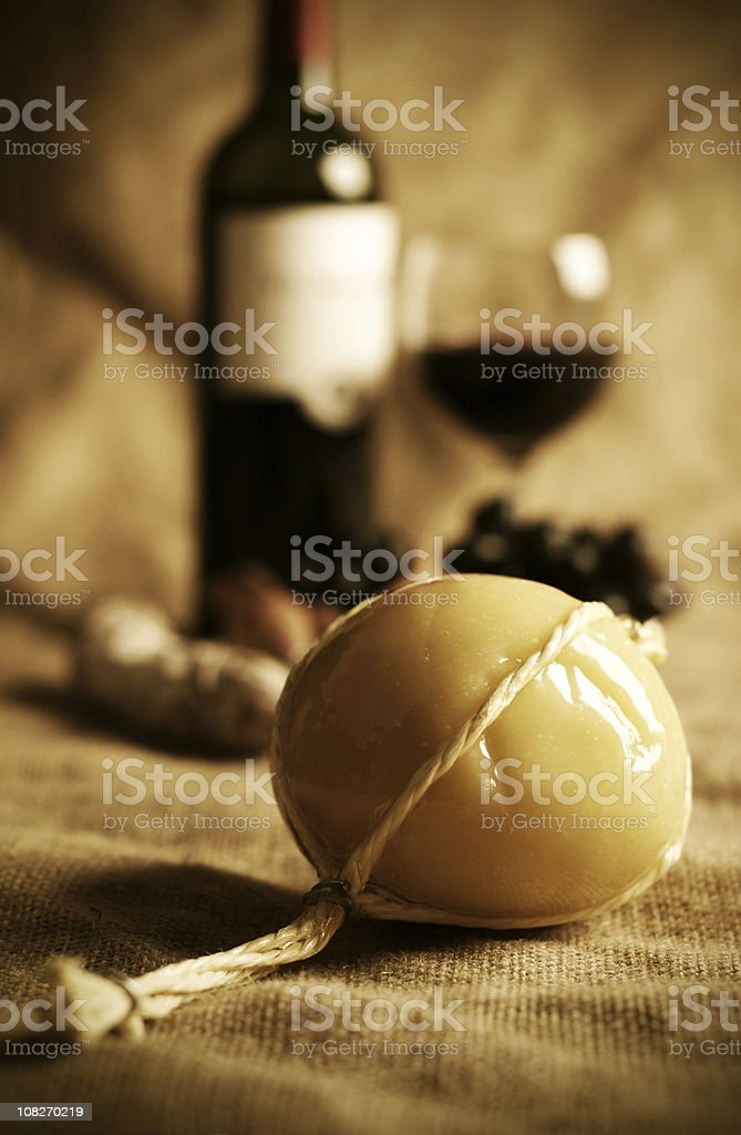 Traditional Provolone Cheese with Wine stock photo