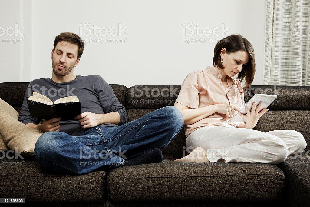 Traditional reading vs technology royalty-free stock photo