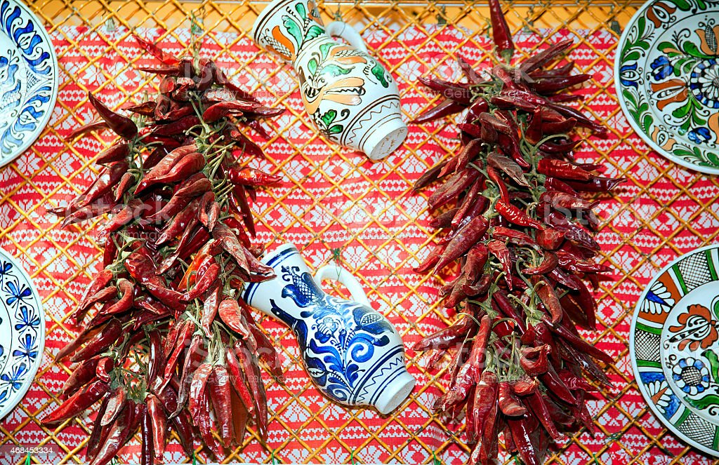Traditional red hungarian peppers and folk art objects for sale stock photo