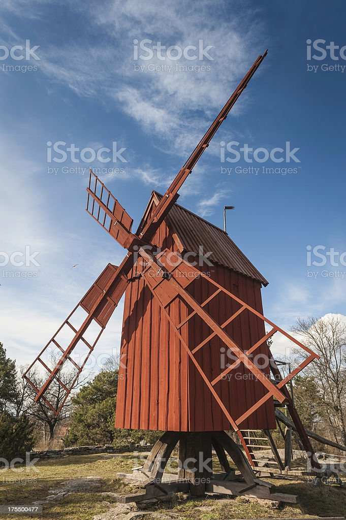Traditional red wooden windmill royalty-free stock photo