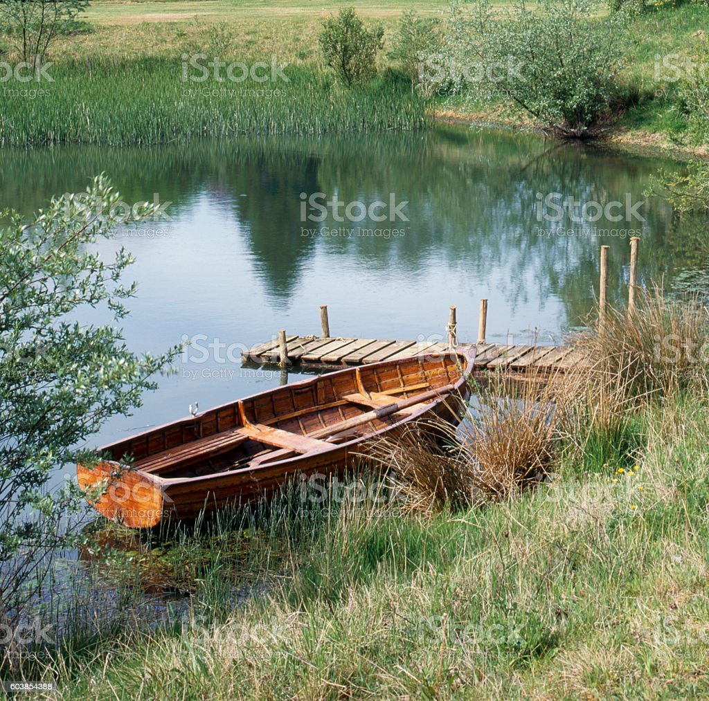 Traditional rowing boat moored stock photo
