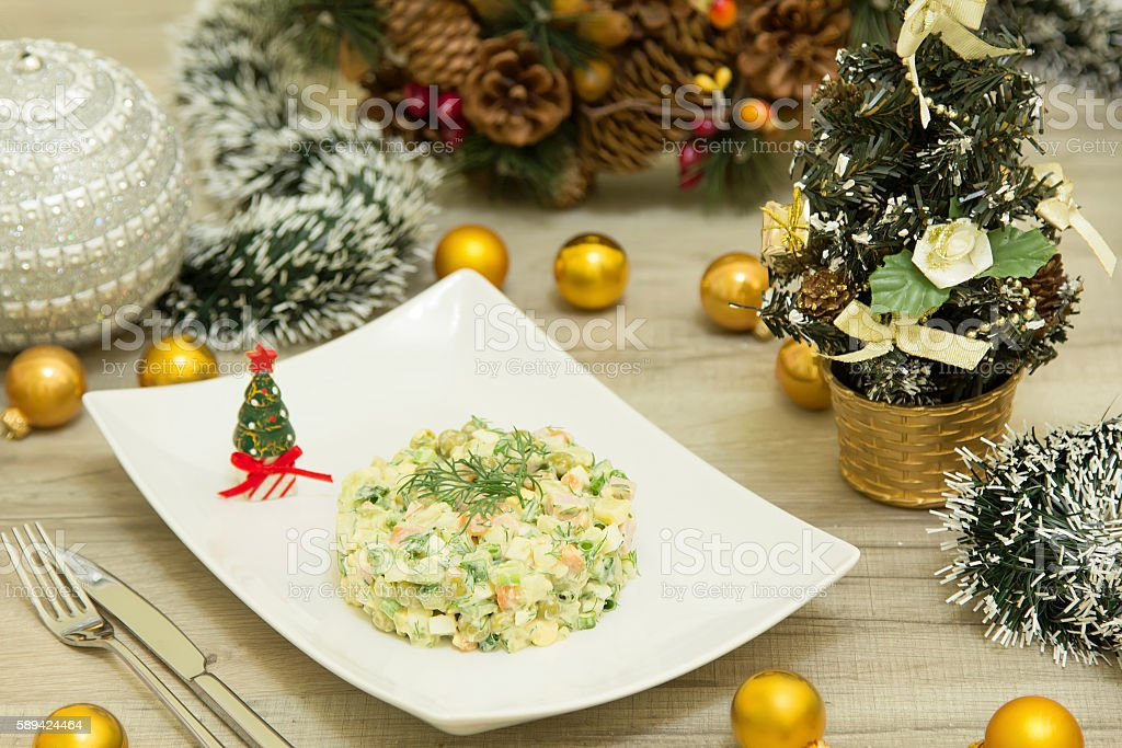 Traditional Russian christmas salad Olivier with sausage and fre stock photo