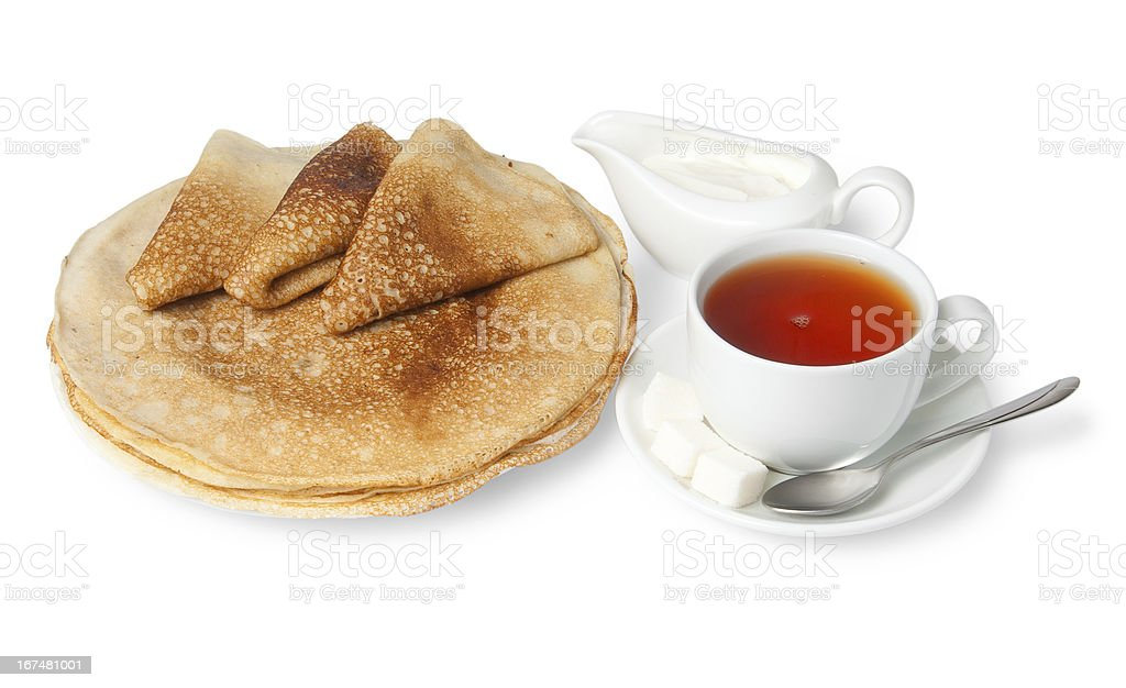 Traditional russian pancakes with sour cream and tea royalty-free stock photo