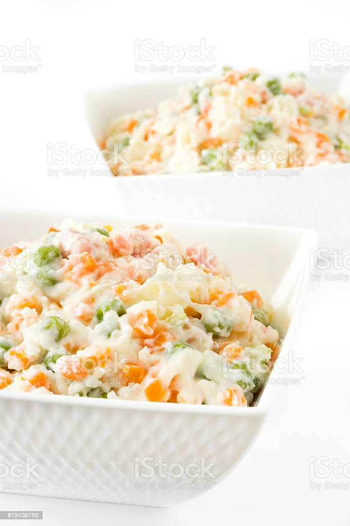 Traditional russian salad on white background stock photo