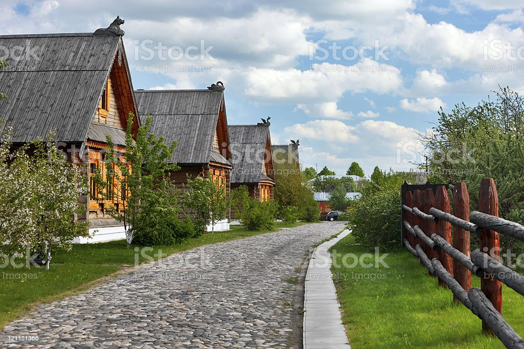 Traditional russian wooden houses in spring. stock photo