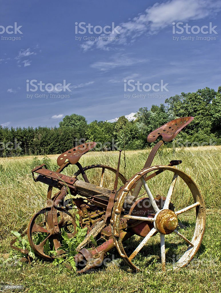 Traditional rusty horse powered grass mower & haymaker stock photo