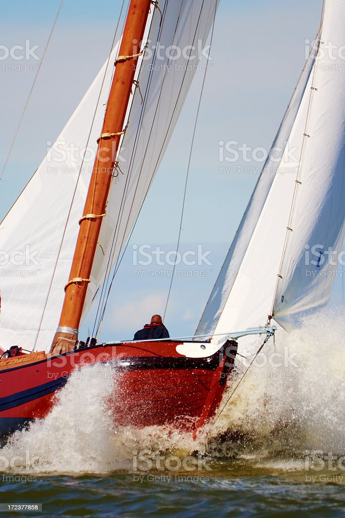 Traditional sailing vessel in the midst of a regatta royalty-free stock photo
