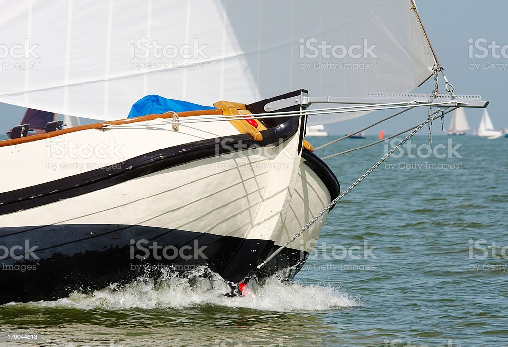Traditional sailing vessel in the midst of a regatta stock photo