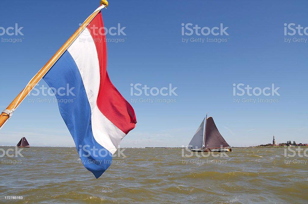 Traditional sailing vessels in the midst of a regatta royalty-free stock photo
