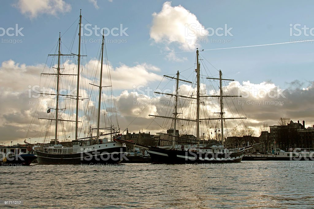 Traditional sailingboats in Amsterdam harbor Netherlands stock photo