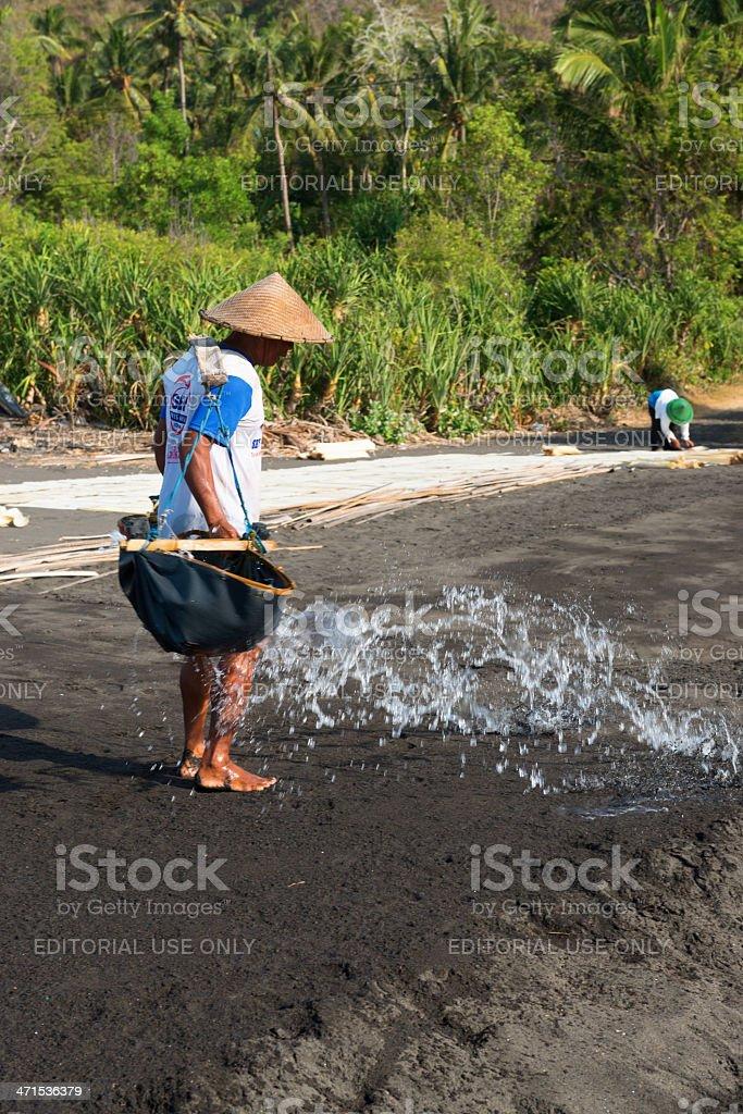 Traditional sea salt production on Bali stock photo