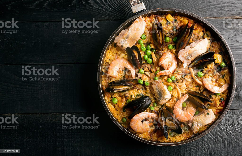 Traditional seafood paella in the pan stock photo