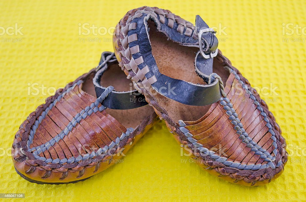 Traditional Serbian footwear on yellow royalty-free stock photo
