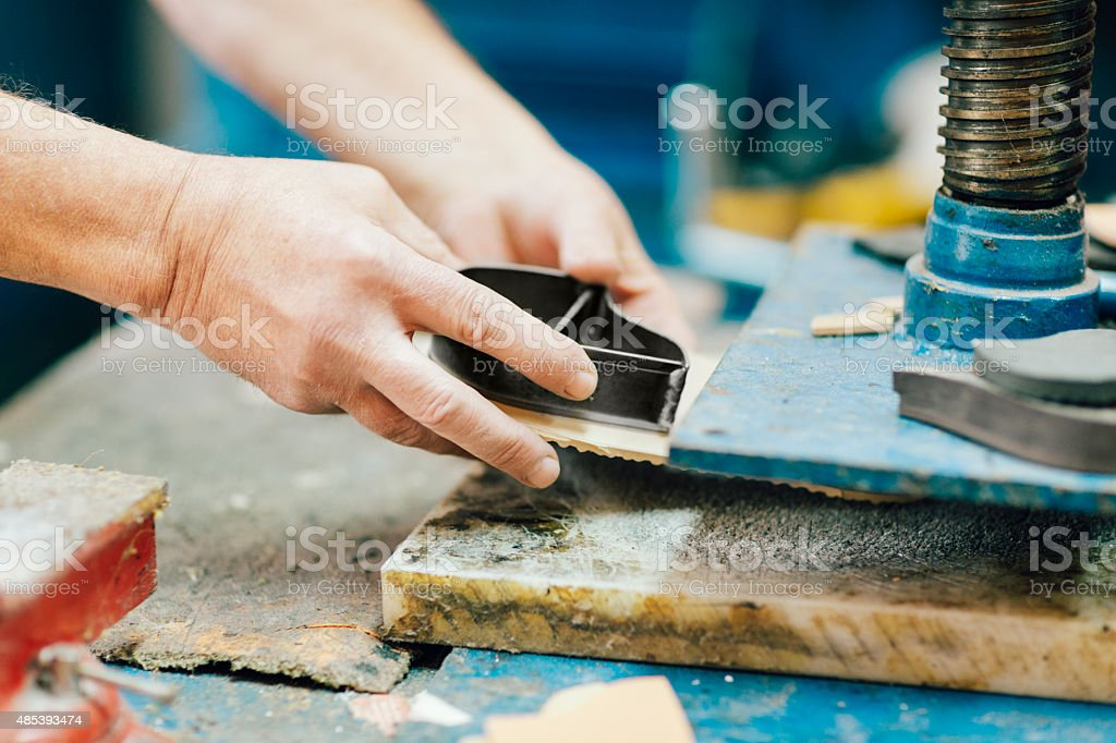 Traditional Shoemaker at work. stock photo
