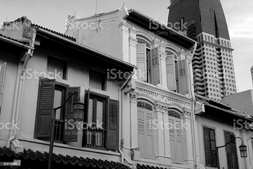 Traditional Shop House with Modern Skyscraper stock photo
