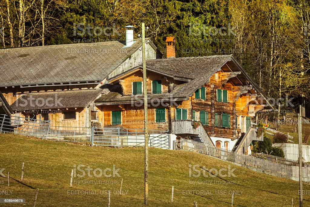 Traditional Simmental style Farmhouse below in the Färmeltal stock photo