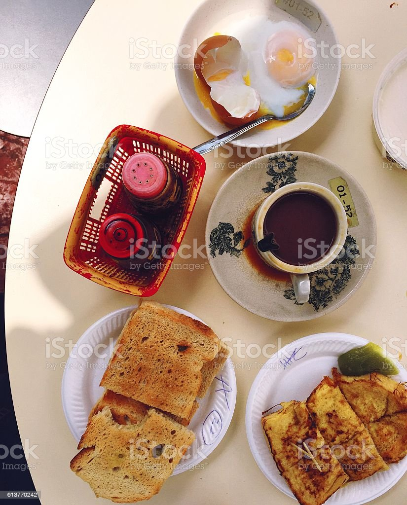 Traditional Singapore food court breakfast: kaya toast, poached eggs, coffee stock photo