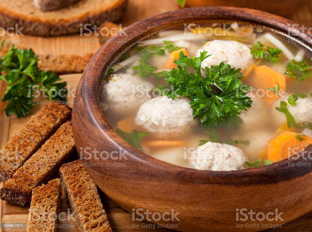 Traditional soup with meatballs and croutons stock photo
