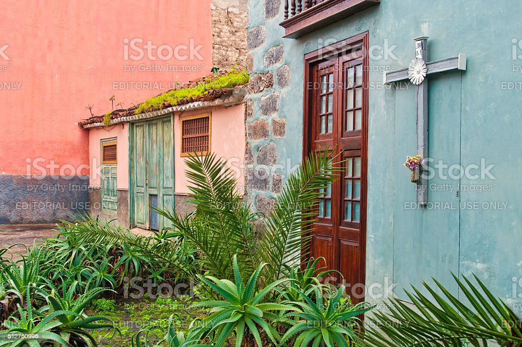 traditional spanish houses with big cross and plants stock photo