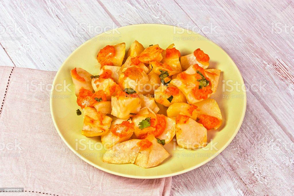 Traditional spanish patatas bravas dish with hot sauce stock photo