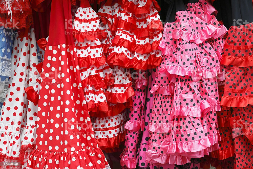 Traditional Spanish Sevillana dresses hanging outside a shop in Cordoba royalty-free stock photo