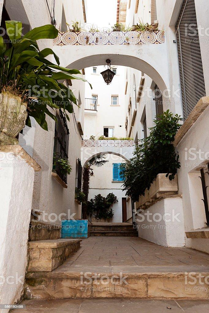 Traditional Spanish street in Roc de Sant Gaieta. stock photo