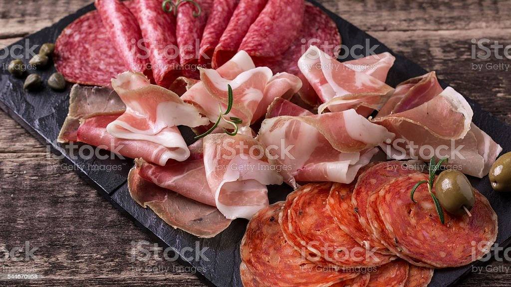 Traditional spanish tapas or italian antipasti stock photo