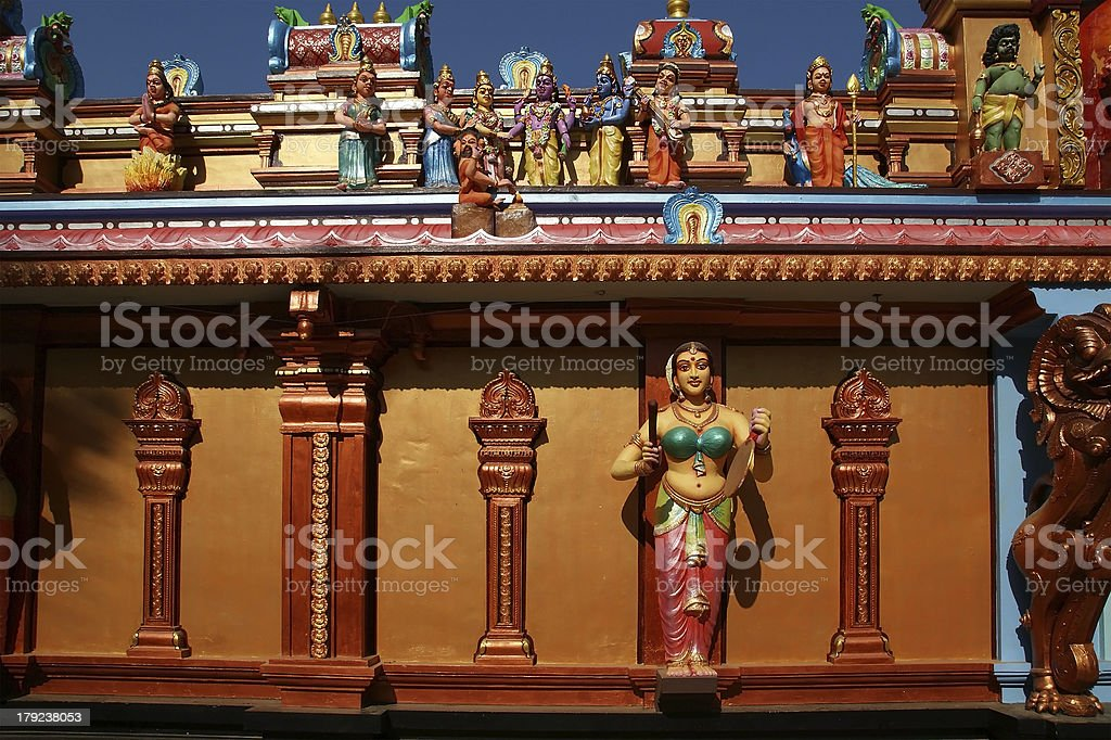 Traditional statues of gods and goddesses in the Hindu temple royalty-free stock photo