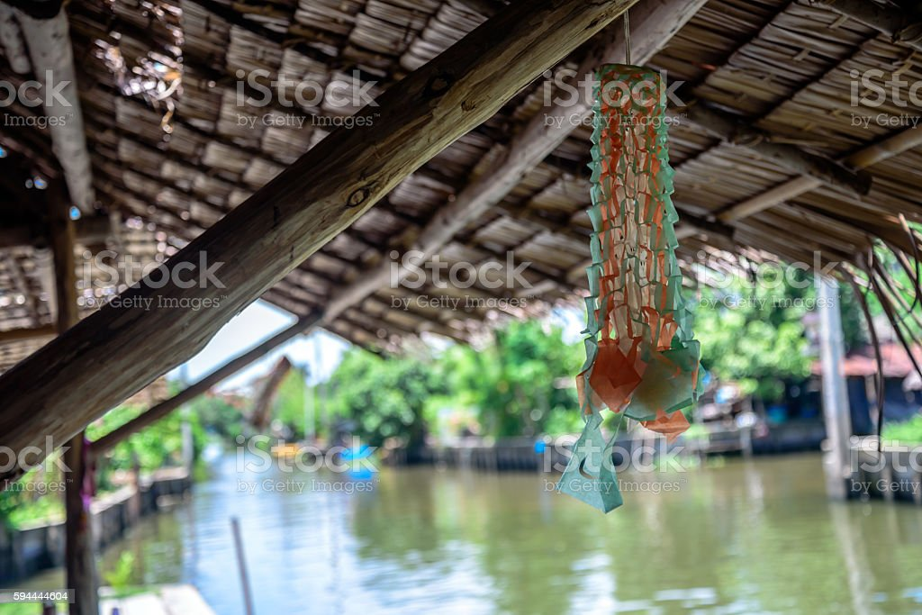 Traditional straw roof of rural house near riverside in Thailand stock photo