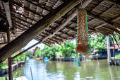 Traditional straw roof of rural house near riverside in Thailand