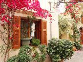 traditional street amoung bougainvillaea in chanya city Greece