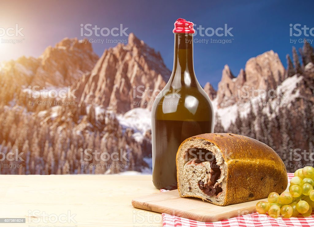 Traditional Strudel bread with black olives ,wine stock photo