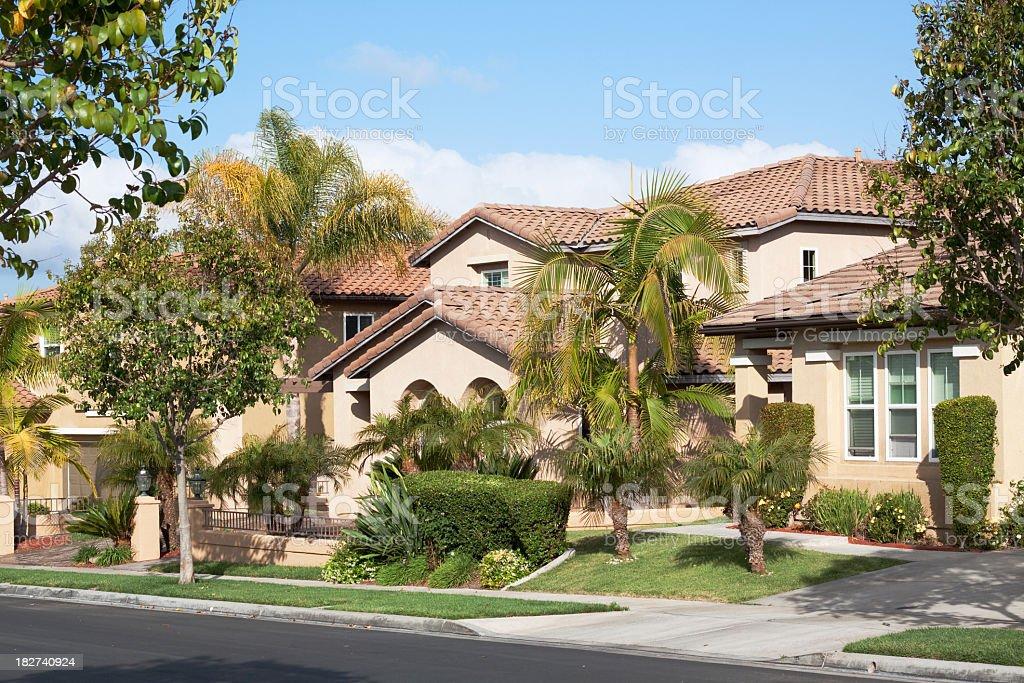 A traditional stucco home in a nice neighborhood stock photo