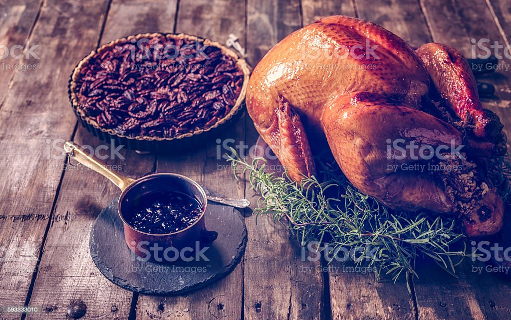 Traditional Stuffed Turkey and Pecan Pie stock photo
