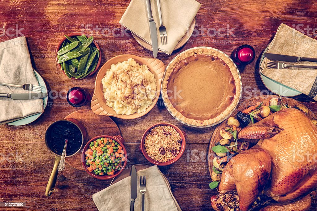 Traditional Stuffed Turkey Holiday Dinner with Vegetables and Pumpkin Pie stock photo