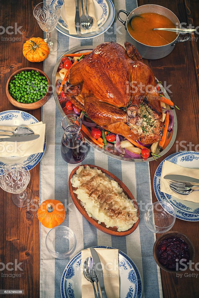 Traditional Stuffed Turkey with Side Dishes stock photo
