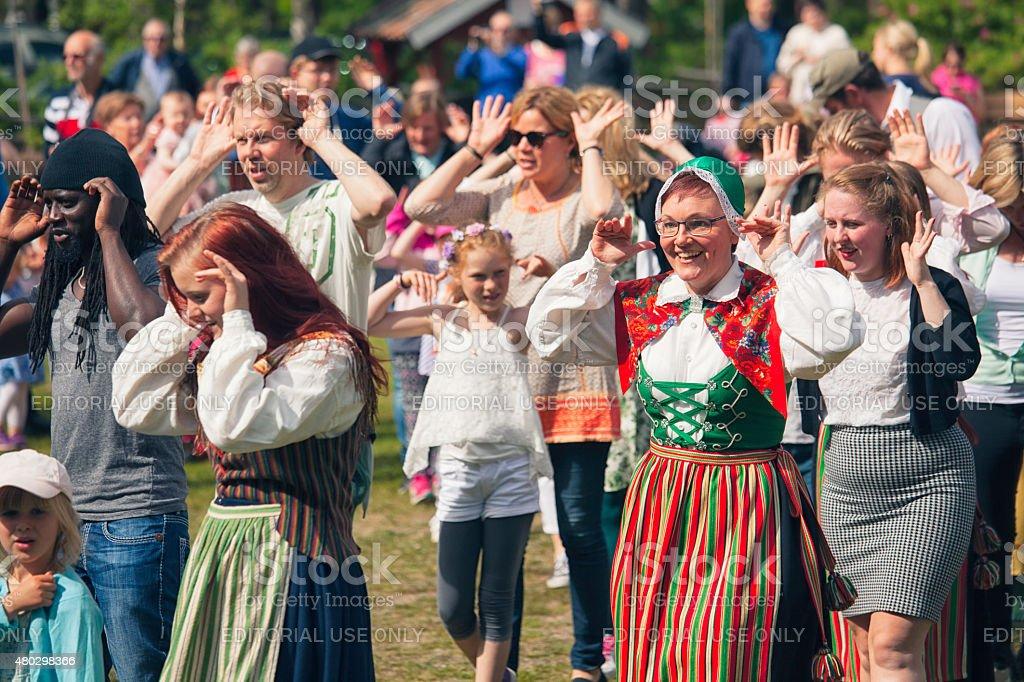 Traditional swedish midsummer singing and dancing stock photo