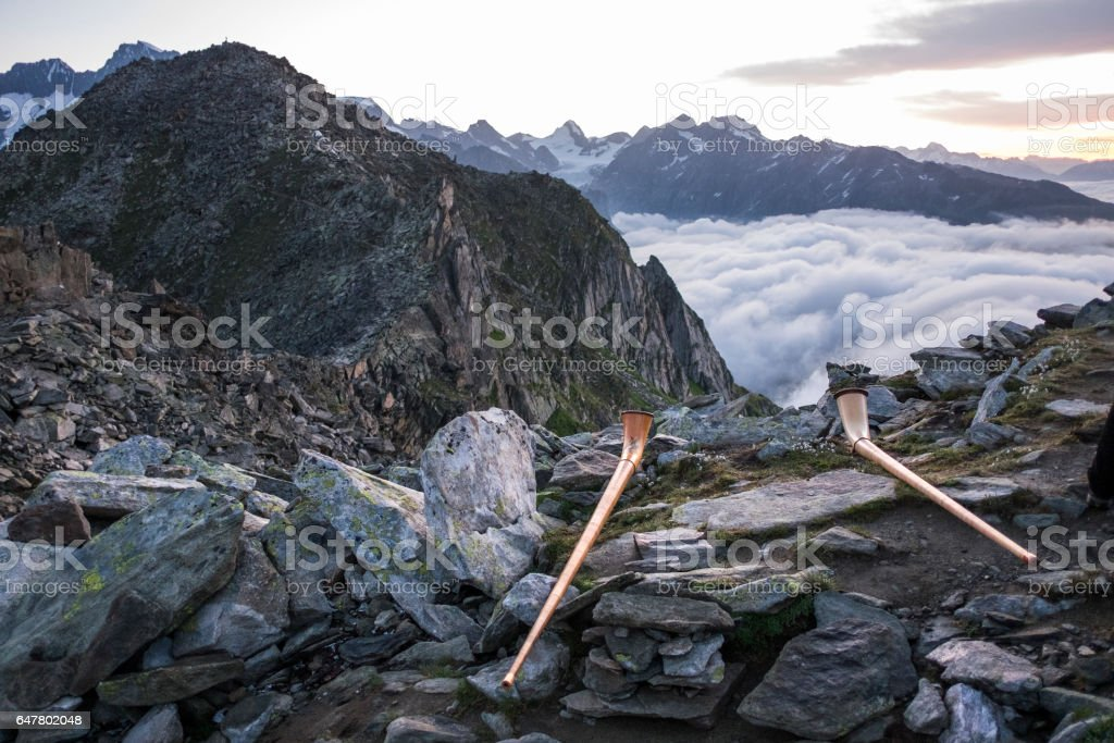 Traditional swiss horn on top of Mount Eggishorn during sunrise. stock photo