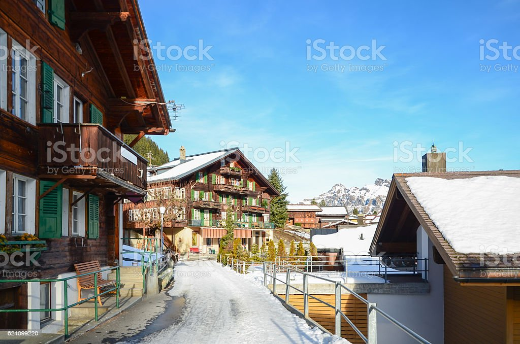 Traditional Swiss House and Alps mountains on background stock photo