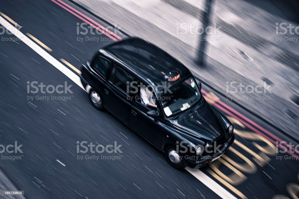 Traditional Taxi Running In A London Road stock photo