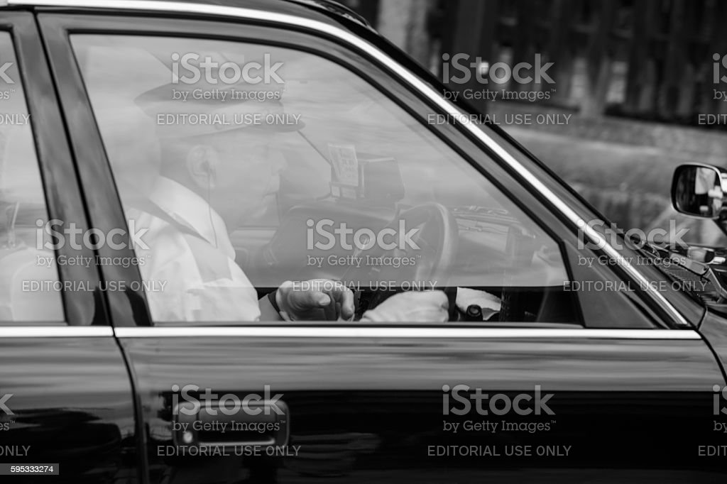 traditional taxi-driver is driving taxi in kyoto japan stock photo