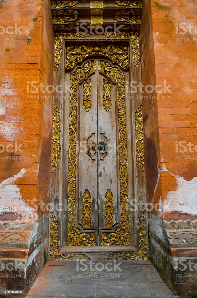 traditional temple door in ubud bali indonesia stock photo