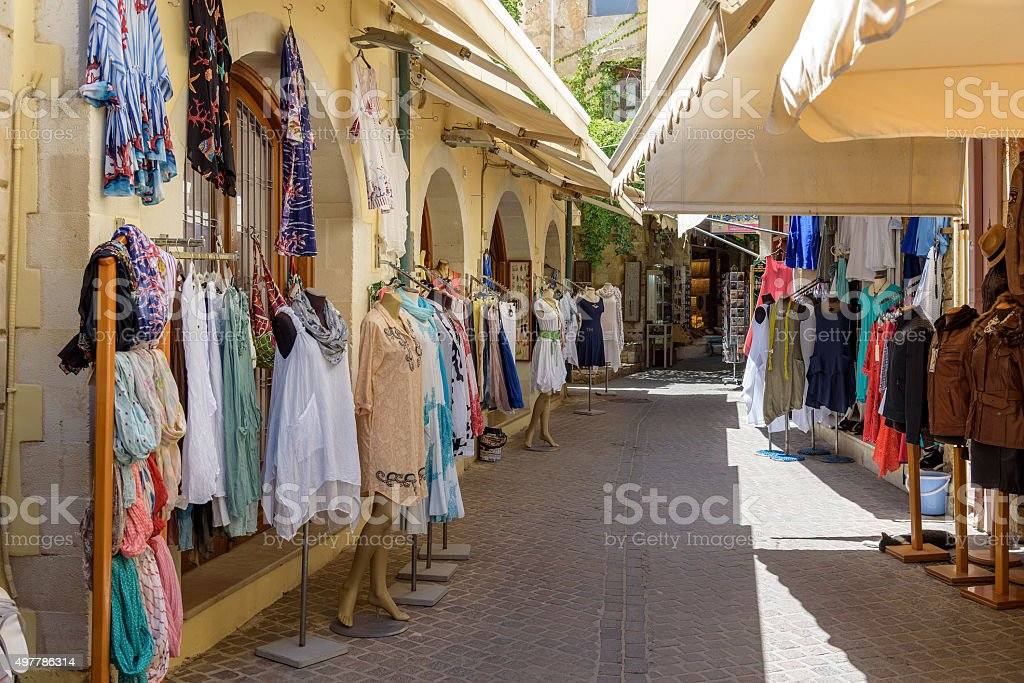 Traditional textiles on a market stall, colorful fabric, handmade souvenirs stock photo