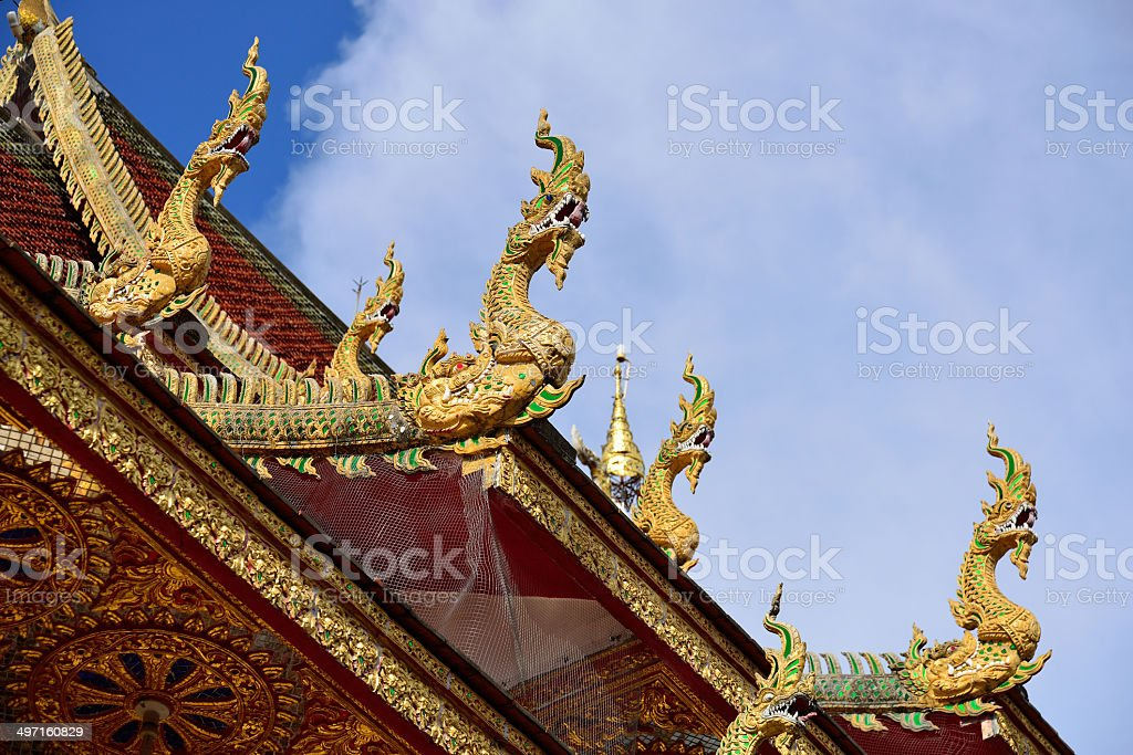 Traditional thai art of naga statue in the roof temple royalty-free stock photo