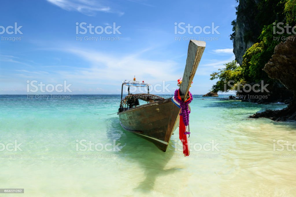 Traditional thai boat on the beach of Phi Phi island in Thailand stock photo