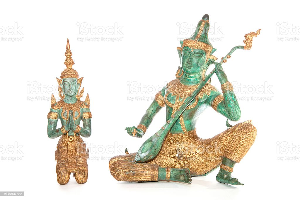 Traditional Thai bronze statues isolated against a white background stock photo